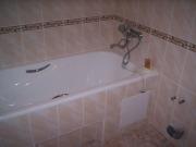 Панели в ванной комнате под ванной