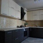 Отделка стены на кухне панелями